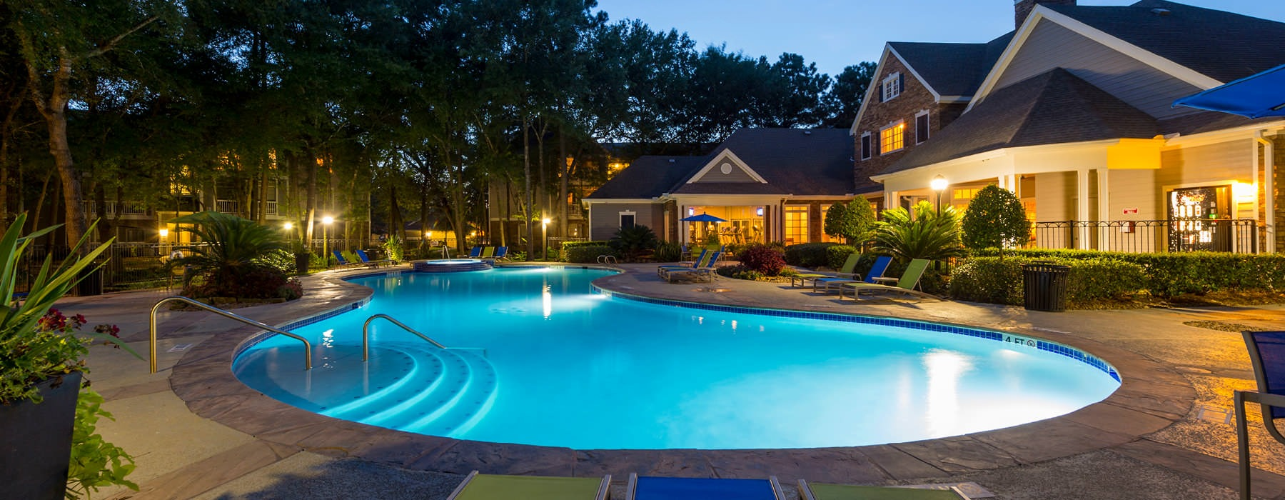outdoor pool lit up for night time swimming